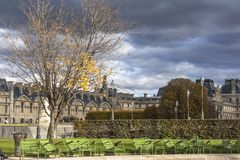 Dark clouds, thunderstorm, park in Paris center. City royalty free stock image