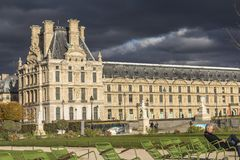 Dark clouds, thunderstorm, park in Paris center. City royalty free stock photo