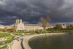Dark clouds, thunderstorm, park in Paris center. City royalty free stock photography