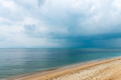 Dark clouds and tropical rain over the sea Stock Images