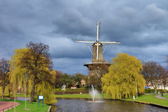 Dark clouds windmill royalty free stock image