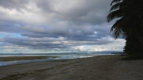 Tropical Siquijor beach early morning. A dark, cloudy early morning clip from Siquijor Island white sand beaches stock video