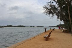 Dark, cloudy, skies. Over a body of water Royalty Free Stock Photos