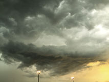 Dark cloudy sky with electrical post Royalty Free Stock Image