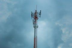 Dark cloudy strom communication tower, high power wifi antenna. Post hotspot long range digital data transport Stock Image