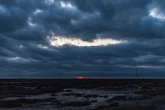 Dark cloudy sunset stock images