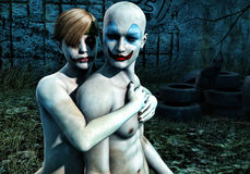 Dark Clowns. A woman and a man in the park, in the dark, gloomy expressions, clowns:  friends or foes Stock Photography
