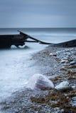 Dark coastal shoreline with jetty Royalty Free Stock Photos