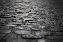 Dark cobblestones shot from the ground with very direct and dramatic light, shot in brussels in belgium stock images
