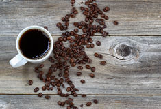 Dark Coffee and beans on rustic wood Stock Image