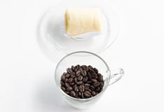 Dark coffee beans with soft roll cake. Royalty Free Stock Photos