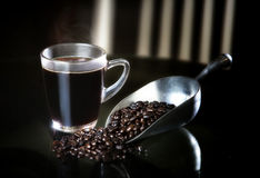 Dark coffee and roast coffee beans Stock Image
