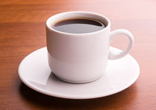 Dark coffee in white cup. Hot coffee on a table Royalty Free Stock Photography