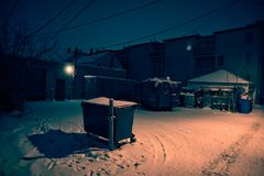 Dark, cold Chicago winter alley with snow and ice at night. Dark cold Chicago winter alley with snow and ice at night royalty free stock photo