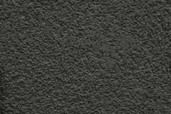 Dark grey concrete wall, detailed. Dark and cold grey concrete textured wall background, structured and detailed stock photo