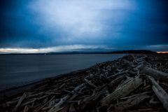 Dark and Cold Keystone Beach on a Winter Sunset On Whidbey Island, Washington, United States. Road Trip to Whidbey Island and stop by Keystone Beach to take some Stock Photos