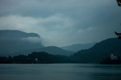 Dark cold weather on Bled lake Stock Image