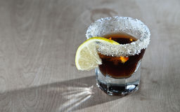 Dark colored shot of alcohol Stock Images