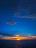 Dark colored sky at dusk - vertical seascape Stock Photos