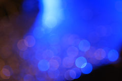Dark colorful bokeh with blue light for nightlife concept. Royalty Free Stock Images