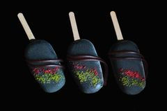 Dark colorful ice cream gelato popsicles glazed with dark chocolate isolated on black background stock photography
