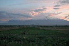 Dark colorfull Sky with Mount Ararat. Dark colorfull  sky with Mount Ararat (Masis) . Black in dark Blue . like smoge landscape. green grass Royalty Free Stock Photo