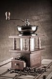 Dark composition of coffee mill and coffee beans Stock Photo