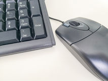 Dark computer keyboard and mouse Royalty Free Stock Photos