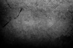 Dark concrete wall. Closeup of textured grey wall, dark edges Stock Image