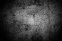 Dark concrete wall. Closeup of textured grey wall, dark edges Royalty Free Stock Images