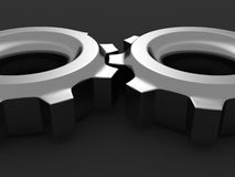 Dark connected metallic cogwheel gears Royalty Free Stock Photography