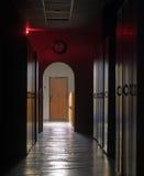 Dark corridor. Leading to light exit Stock Photography