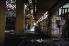 Dark corridor in abandoned factory workshop Royalty Free Stock Photography