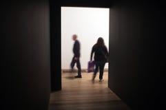 Dark corridor with bright entrance in art gallery Royalty Free Stock Image