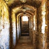 Dark corridor in dungeon Stock Images