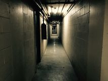 Dark corridor. Dark and gloomy hallway in and old building Royalty Free Stock Images
