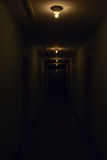 Dark corridor with glowing lamps. On the ceiling Stock Image