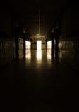 Dark corridor. And light at door Royalty Free Stock Photography