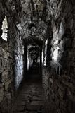 Dark corridor on medieval castle. Long deep dark corridor on medieval castle stock photography