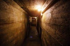 Dark corridor of old underground Soviet bunker under military artillery fortification Stock Photo