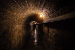 Dark corridor of old underground Soviet military bunker under artillery fortification. Royalty Free Stock Photos