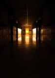 Dark corridor to sun at the door Royalty Free Stock Photos