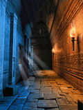 Dark corridor with torches. Dark corridor with burning torches in a ruined building Royalty Free Stock Images