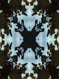 Dark Cow Hide Pattern. Black and blue kaleidoscope cow hide pattern stock photography