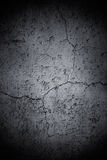 Dark Cracked Wall. An old, dark concrete wall with cracks and other damage