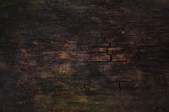 Dark cracked wooden surface Royalty Free Stock Images