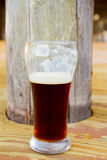 Dark Craft Beer Homebrew. Homebrew beer brewed for a wedding reception in the Belgian ale variety in a glass Royalty Free Stock Photos
