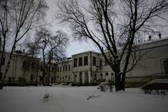 Dark and creepy abandoned haunted hospital in cold winter night.  stock photography