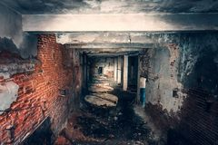 Dark creepy corridor, first person view, going with flashlight in dirty grungy tunnel in abandoned building, horror escape concept royalty free stock photo