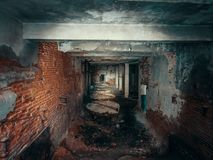 Dark creepy corridor, first person view, going with flashlight in dirty grungy tunnel in abandoned building, horror escape concept stock photos